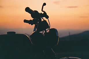 motorcycle on beach at sunset