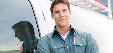 Service worker standing outside of commercial van