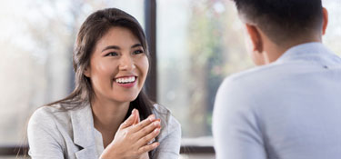 woman looking at man as they discuss something